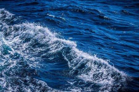 Blue water on the surface of the Pacific Ocean. Natural background. Toned.