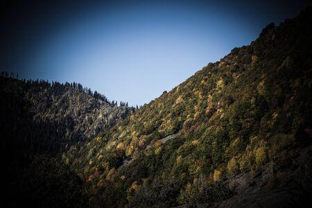 Amazing autumn mountain landscape in Svaneti. Georgia. Toned.