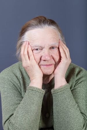 Portrait of elderly woman. Irony.
