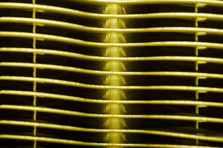 Metal surface of the radiator for a tecnical background. Toned.