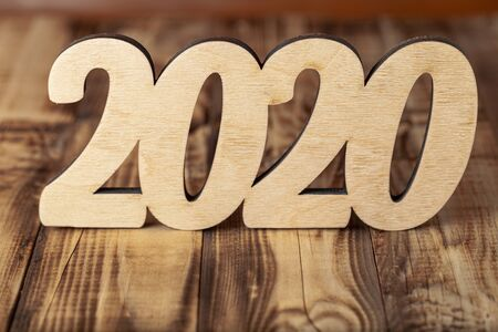 New year composition with wooden figures 2020.