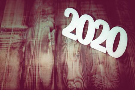 New year composition with wooden figures 2020. Toned. Zdjęcie Seryjne