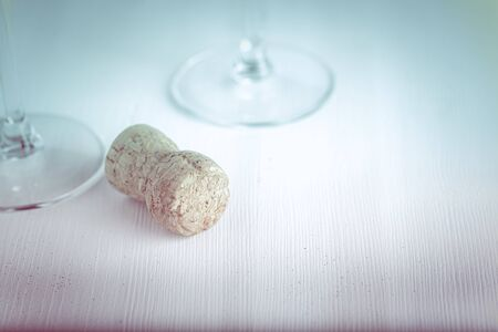 New year composition with champagne cork on a light background. Toned.