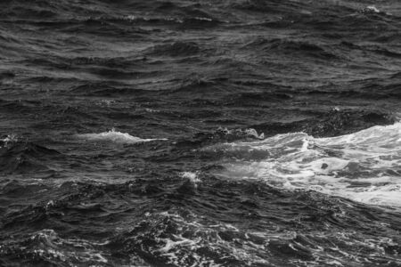 Waves of stormy cold sea on the south of Iceland. Toned. Фото со стока - 129253269