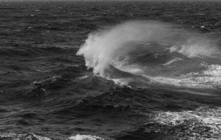 Waves of stormy cold sea on the south of Iceland. Toned. Stock fotó