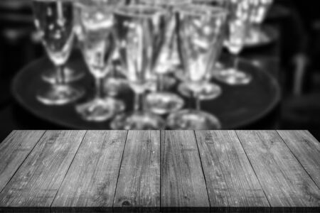 Many wine glasses. View from wooden table. Collage. Toned.