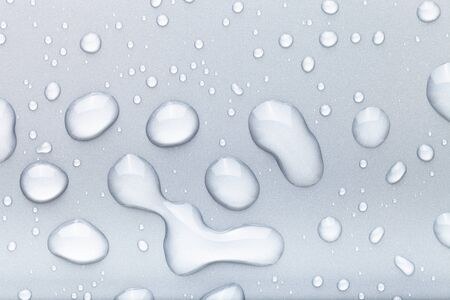 Drops of water on a color background. Gray. Stock Photo