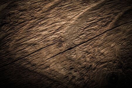 Surface of old textured wooden board for background. Toned.