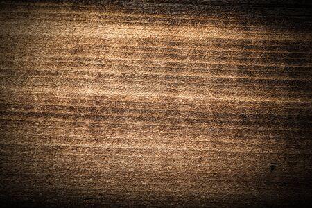 Surface de la vieille planche de bois texturée pour le fond. Tonifié.