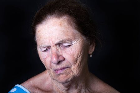 Portrait of an elderly woman with bright emotions on his face.