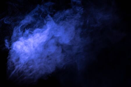 Jet of smoke on black background. Selective focus. Toned. Фото со стока