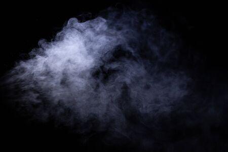 Jet of smoke on black background. Selective focus. 写真素材