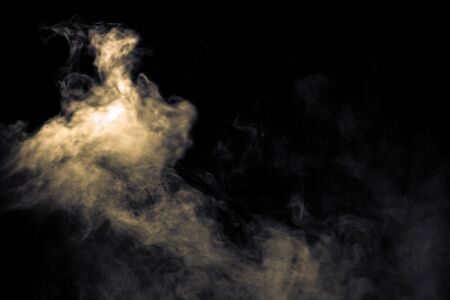 Jet of smoke on black background. Selective focus. Toned.