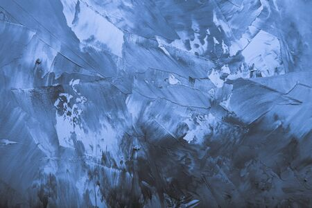 Textured plastered background with a variety of arbitrary stains. Blue. Toned.
