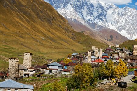 View of the village of Ushguli in a beautiful autumn landscape with white clouds in Svaneti. Georgia.