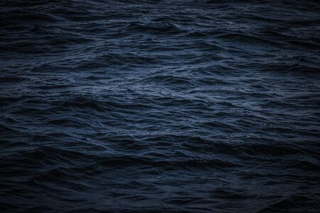 Surface of a calm blue sea. Selective focus. Shallow depth of field. Toned.