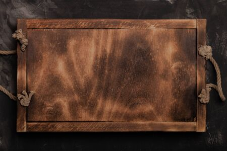 Handmade wooden rustic items on a plastered textured table for background. Space fo text.