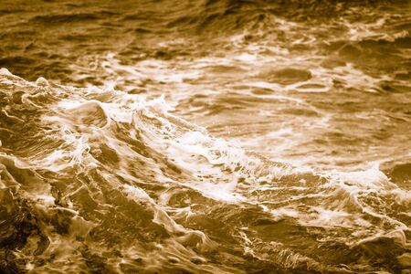 White crest of a sea wave. Selective focus. Shallow depth of field. Toned. 写真素材