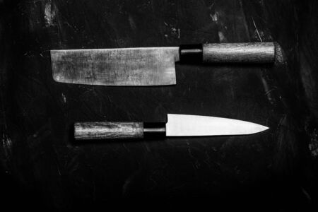 Chopping knives on a dark table. Toned.