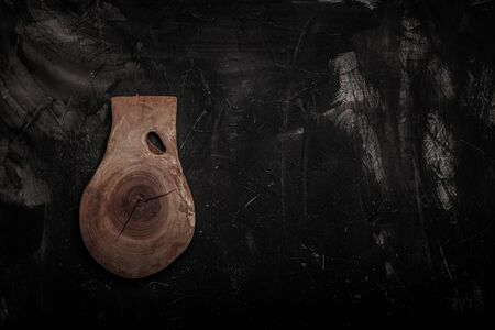 Handmade wooden rustic items on a plastered textured table for background. Space fo text. Toned. 写真素材