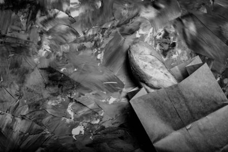 Composition with a bread on a textured plastered surface. Toned. 写真素材