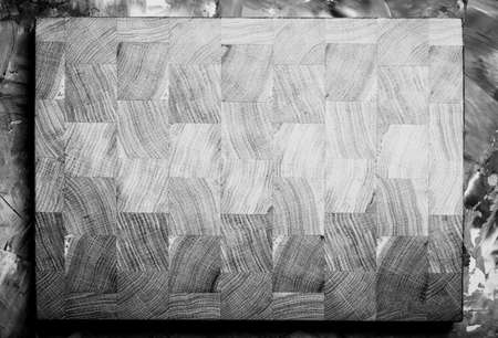 Composition with a cutting board on a textured plastered surface. Toned. 版權商用圖片