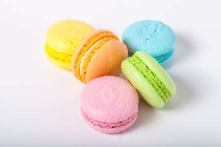 Colorful cake macaroons on a light background. Standard-Bild