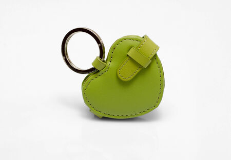 Green leather trinket isolated on white photo