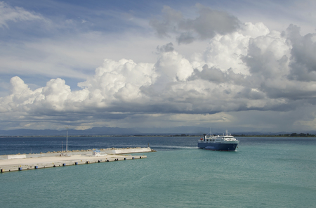 cruiseliner: Ferry returning to port under a dramatic sky