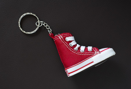 Key chain with mini basketball shoe on leather pad