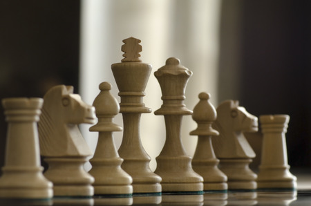 maneuvering: conceprt with chess pieces and lighiting