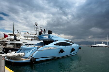 super yacht: Fast and luxury yacht under a heavy cloudscape at marina Zeas , Piraeus , Greece