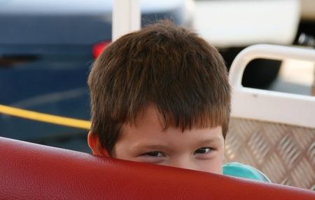 low self esteem: Hidden glances.Boy in sight seen train Stock Photo