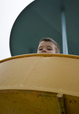 low self esteem: At the playground .Little boy looking down