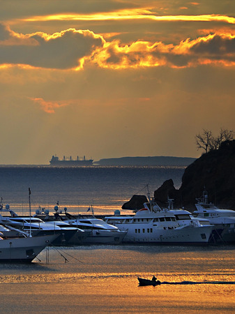 motorboats: Three different motorboats under a golden sky in the Marina