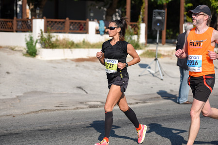 dozens: ATHENS,GREECE - NOV 8: 33nd Athens Classic Marathon.Over 45,000 athletes from dozens of countries took part in the classic authentic marathon ,November 8, 2015 in Marathon City, Athens,Greece Editorial
