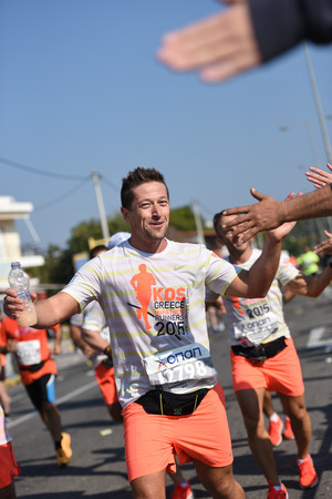 dozens: ATHENS,GREECE - NOV 8: 33nd Athens Classic Marathon.Over 45,000 athletes from dozens of countries took part in the classic authentic marathon ,November 8, 2015 in Marathon City, Athens,Greece Editorial