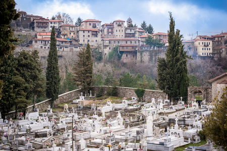 and arcadia: View of the historic  village of Dimitsana with beautiful traditional architecture and bellow the orthodox graveyard. Peloponnese,Arcadia,Greece Stock Photo