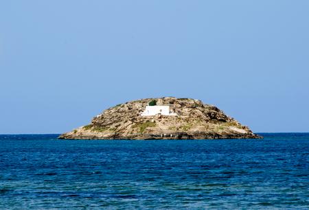 sporades: Deserted small island with a white small chapel. Aegean sea, Sporades islands, Skyros, Greece Stock Photo