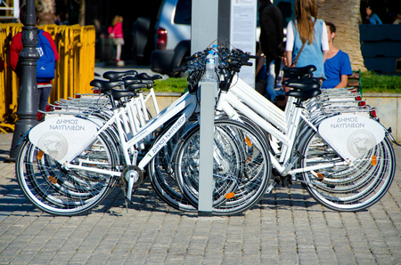 nafplio: NAFPLIO, GREECE - MAY 31, 2016:  Rent a bike at the municipal quay in  Nafplio,Argolis . Bicycles, as the most environmentally,friendly,transport