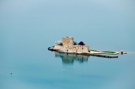 Aerial View of old Venetian fortress and old prison, Bourtzi at the sea.Argolis bay, Nafplio - Greece