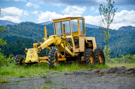 grader: Old grader on mountainous road construction