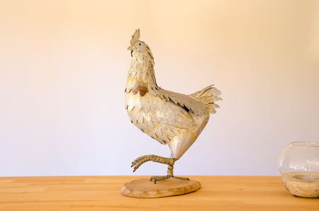 metalic: Decorative metalic rooster on wooden table