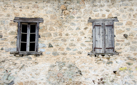 open windows: old Windows one open one closed on a destroyed wall Stock Photo