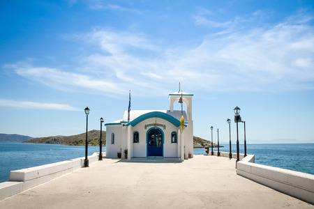 other keywords: Perspective image of a Small greek orthodox chapel with some clouds above