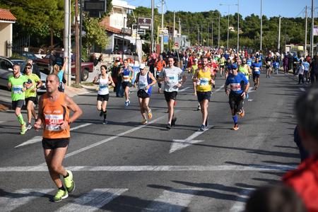 dozens: ATHENS,GREECE - NOV 13-2016: 34nd Athens Classic Marathon.Over 50,000 athletes from dozens of countries took part in the classic authentic marathon ,November 13, 2016 in Marathon City, Athens,Greece