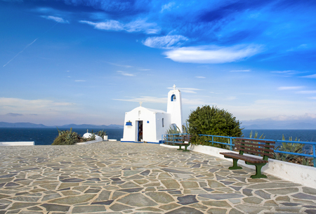 Typical greek place with a white small orthodox chapel dedicated to St. Nikolaos.Rafina,Greece
