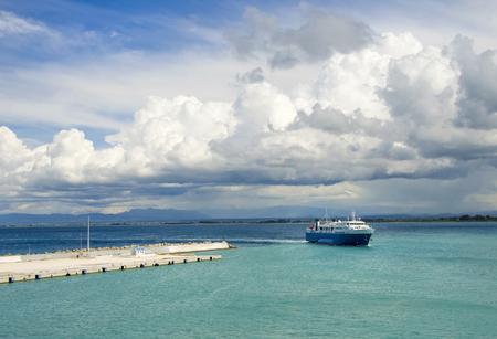Ferry returning to port of Zakynthos island, under a dramatic sky.Greece