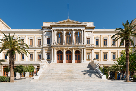 renovated: Syros capital of Cyclades Islands and the beautifull new Classic municipal building.Aegean sea,Greece