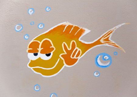 Fish with v sign and bubbles painted on a grey wall